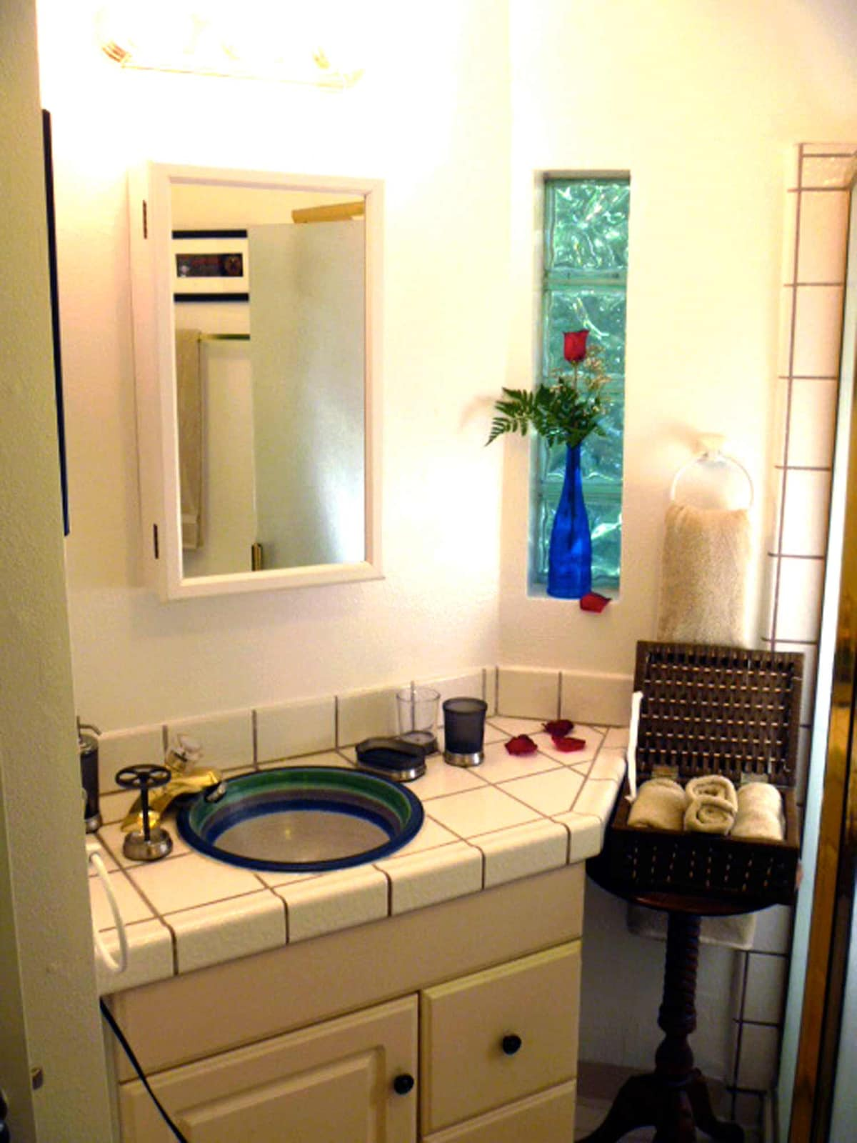 The bathroom is a bit dated, but it does have a hand-made sink and a washer dryer.