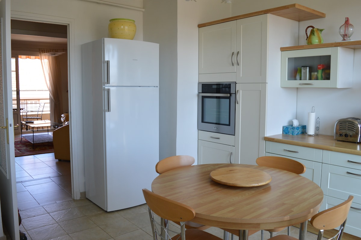Kitchen with fridge, freezer and oven