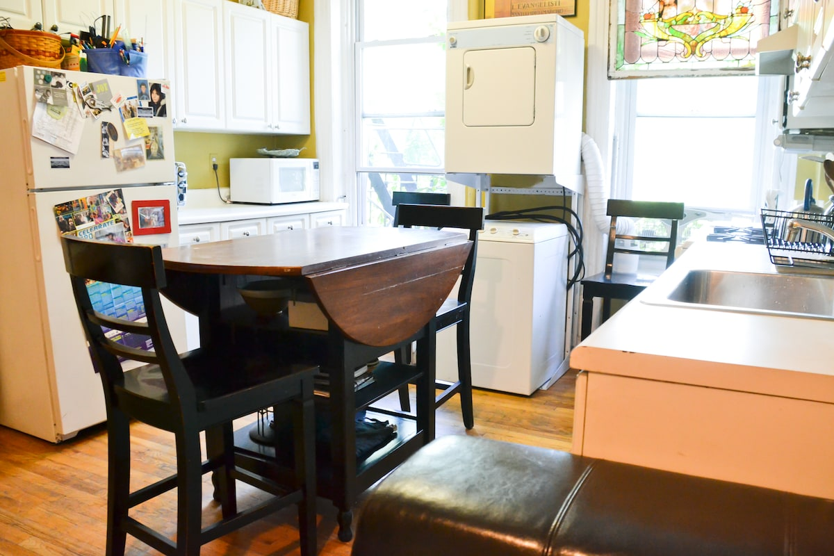 Fully equipped kitchen w/ washer/dryer, dishwasher, coffee maker, microwave and glorious afternoon light.