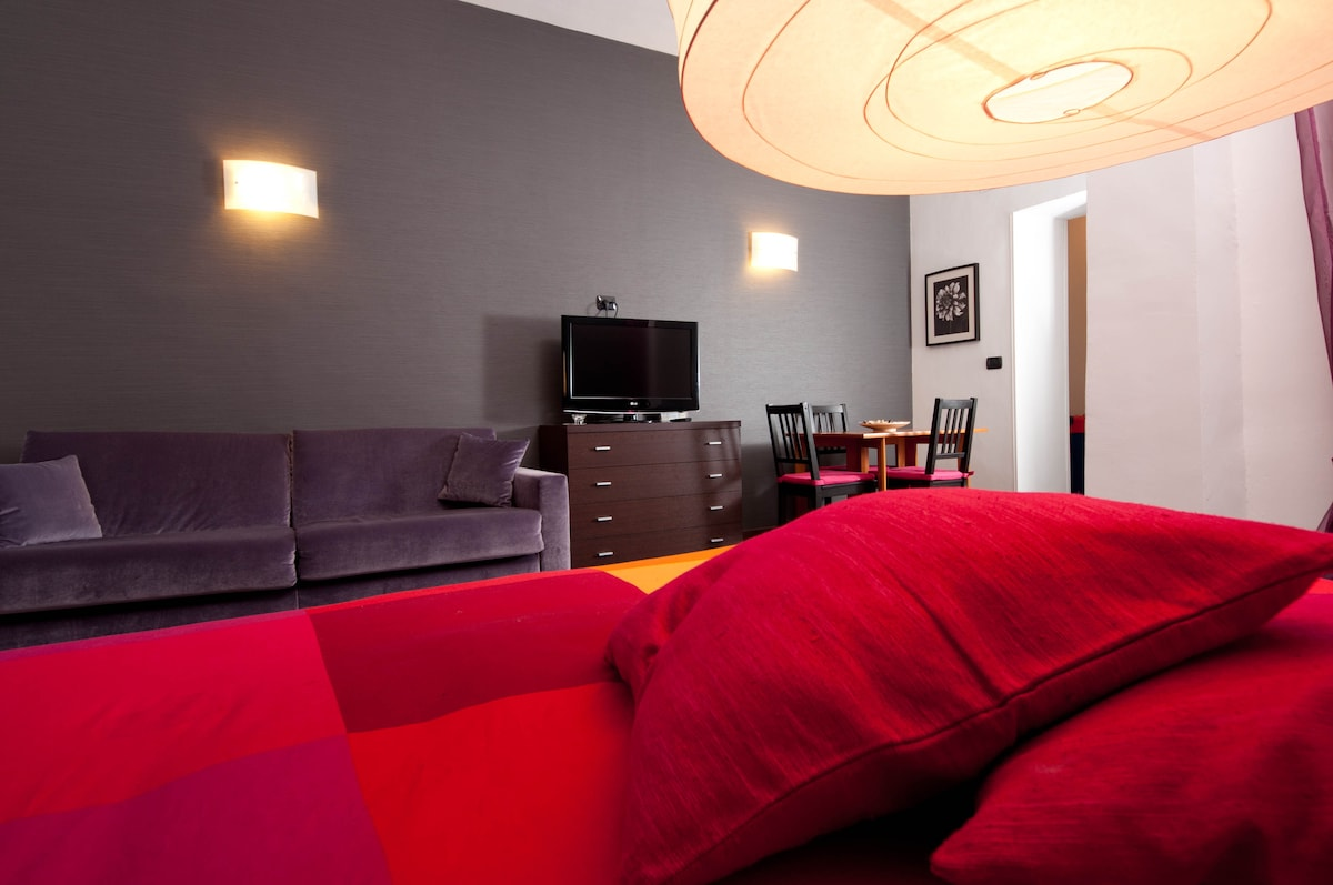 Bedroom with double bed and double sofa bed