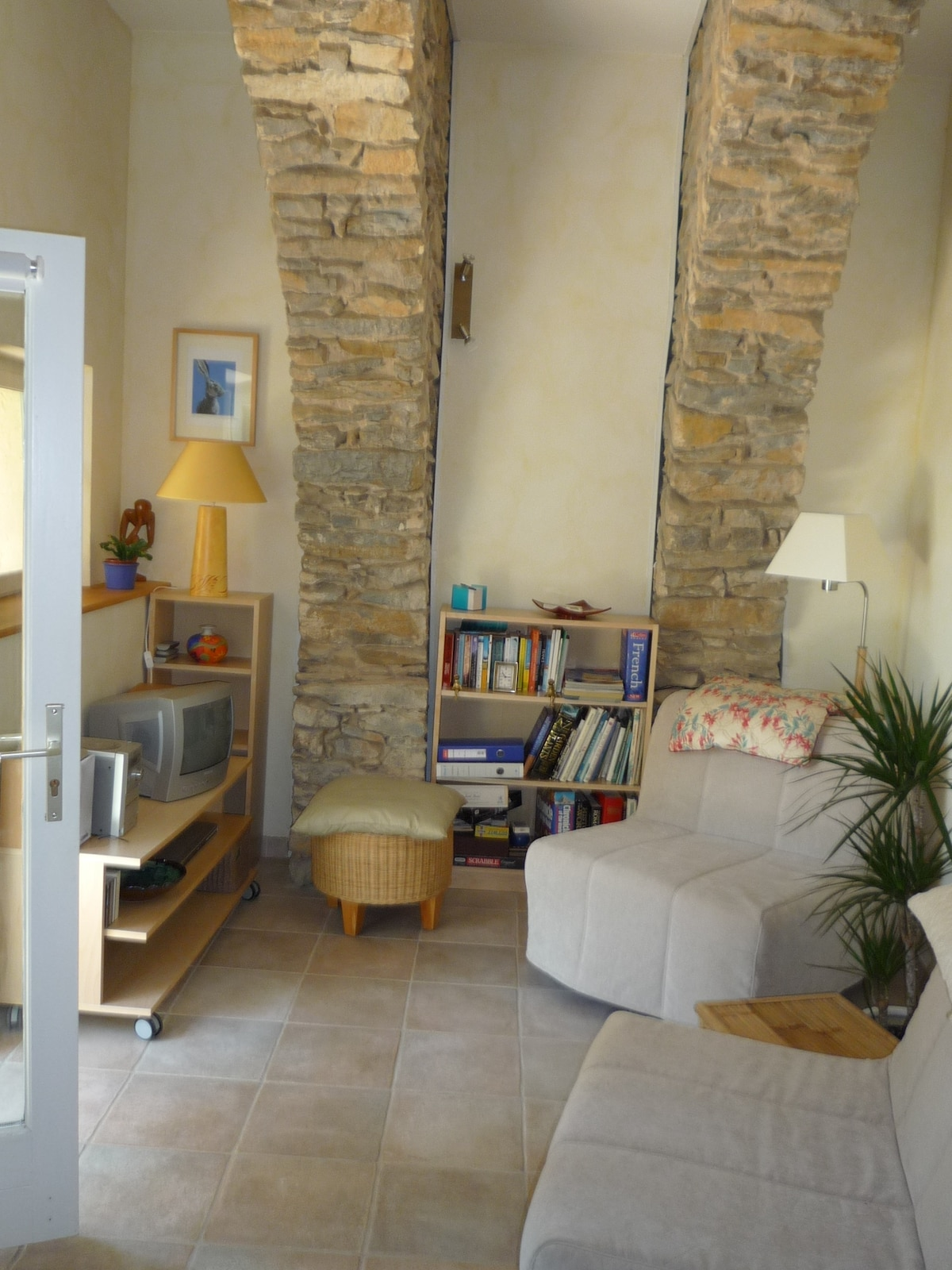 Lounge with exposed stone arches. DVDs, books, free wifi.