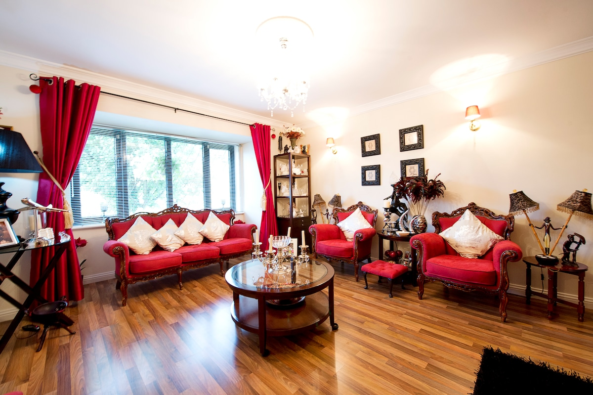 Our  lounge for with large lcd tv and open fireplace