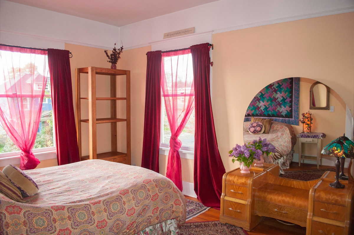 Lovely natural light with room darkening velvet curtains and plenty of storage options to make yourself right at home!