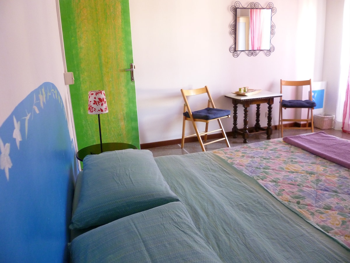 Room ' Chi vuol essere lieto sia..' with view to Fiesole green hills and a little private balcony! The painting is 'Falling flowers' and the colour is blue!