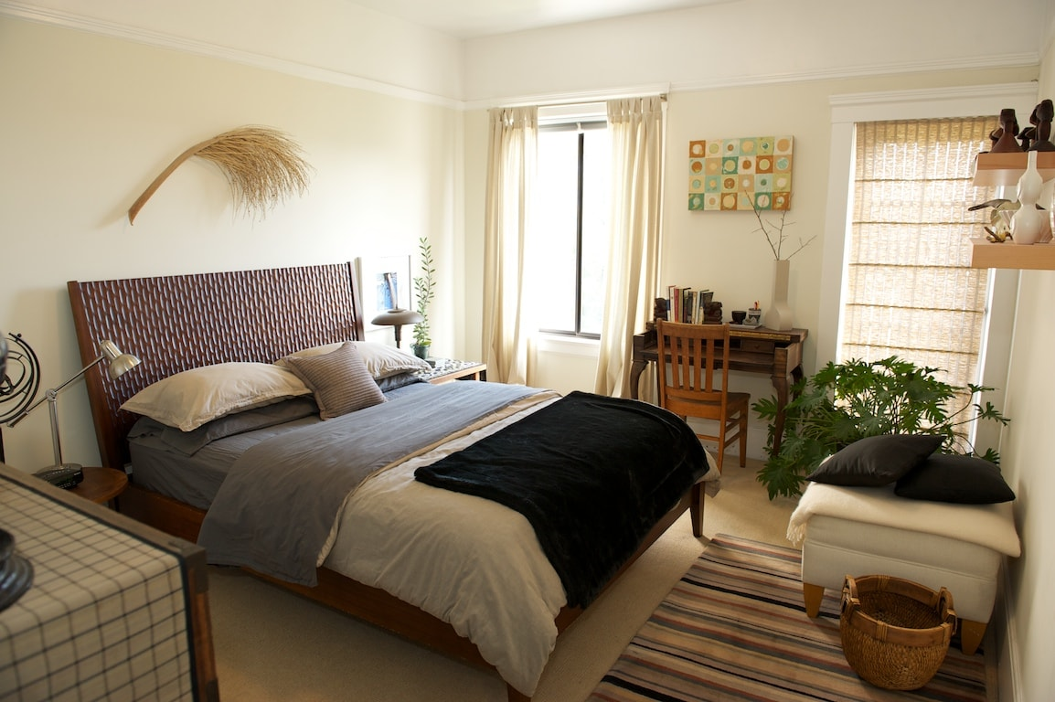 Large sunny bedroom with a comfortable queen bed