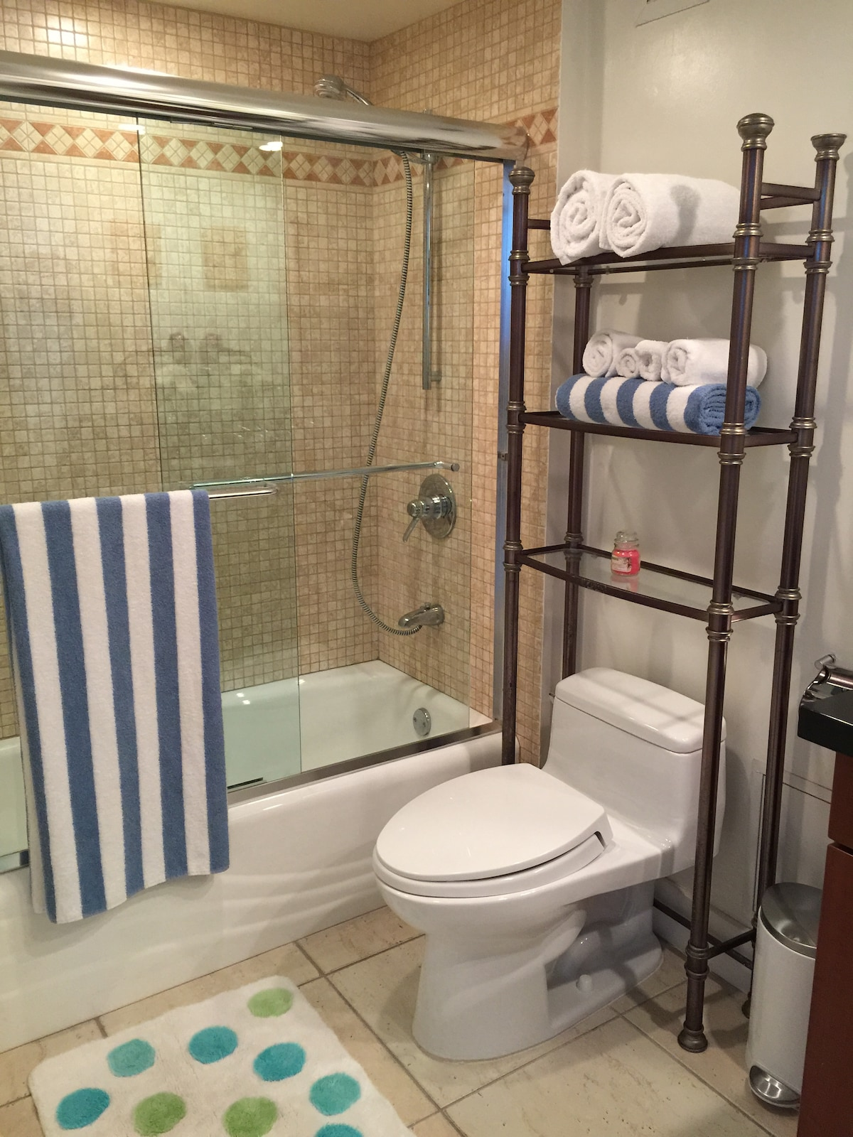 Bathroom with full tub and shower. Granite counter with Full Mirror