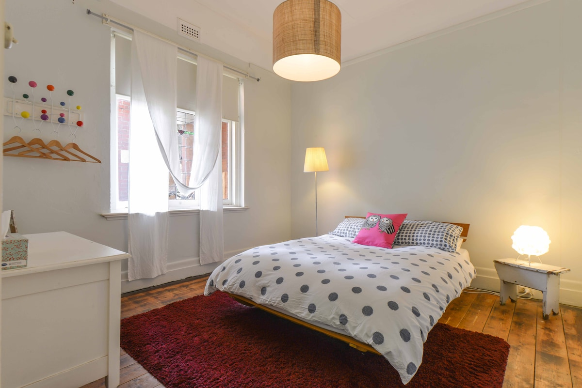 smaller bedroom with view to front garden....
