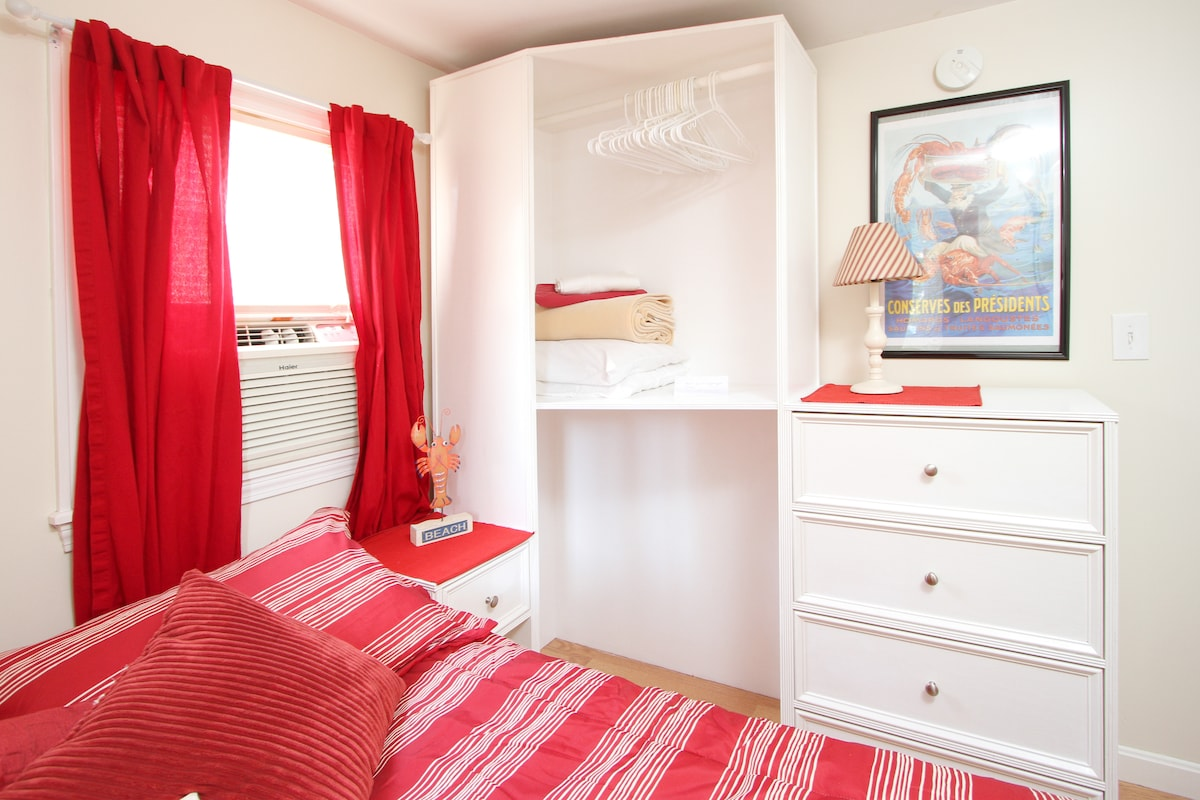 Bedroom with dresser and storage unit