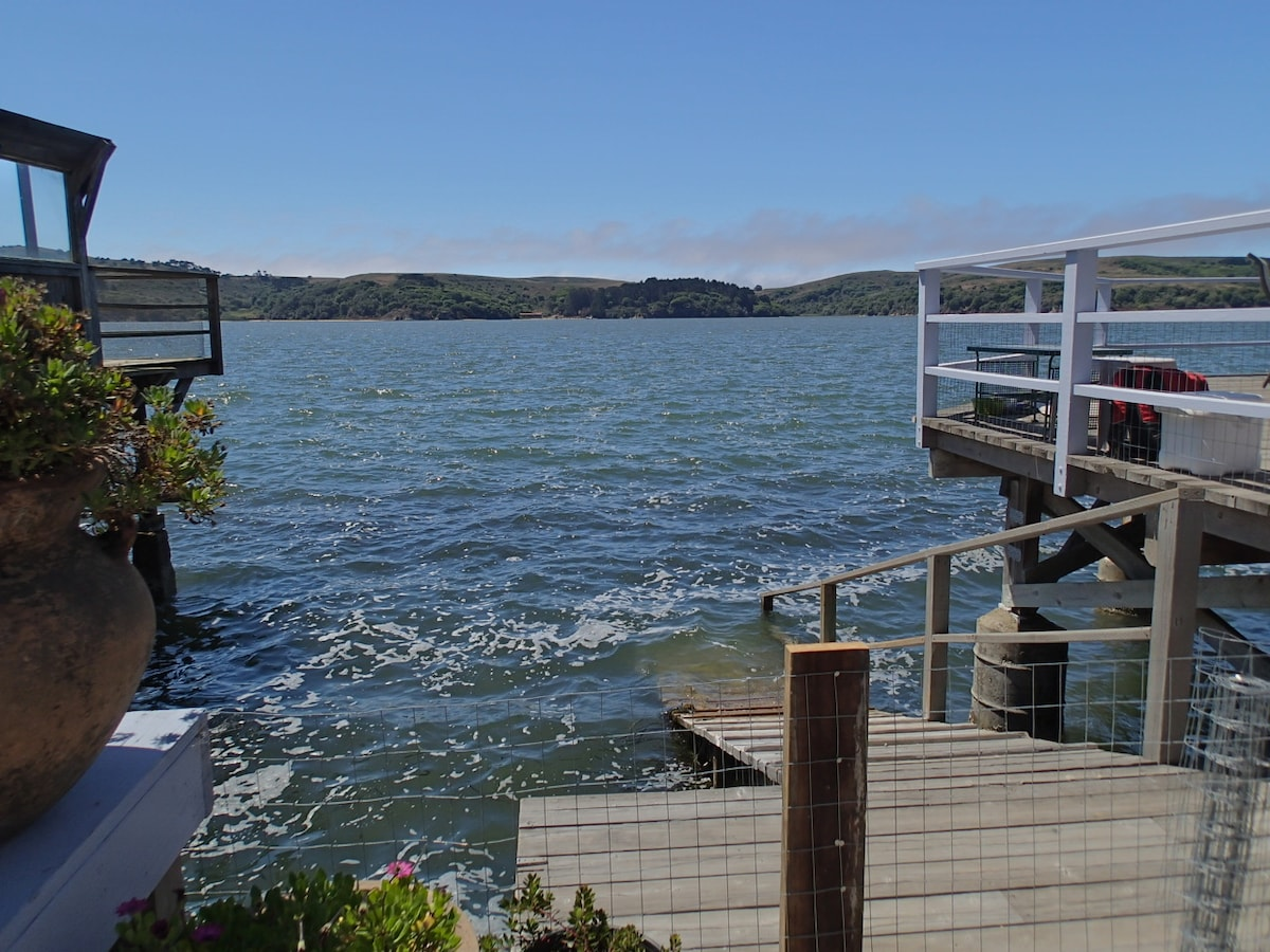 Looking out the sliding glass door to the deck, kayak ramp and Tomales Ba