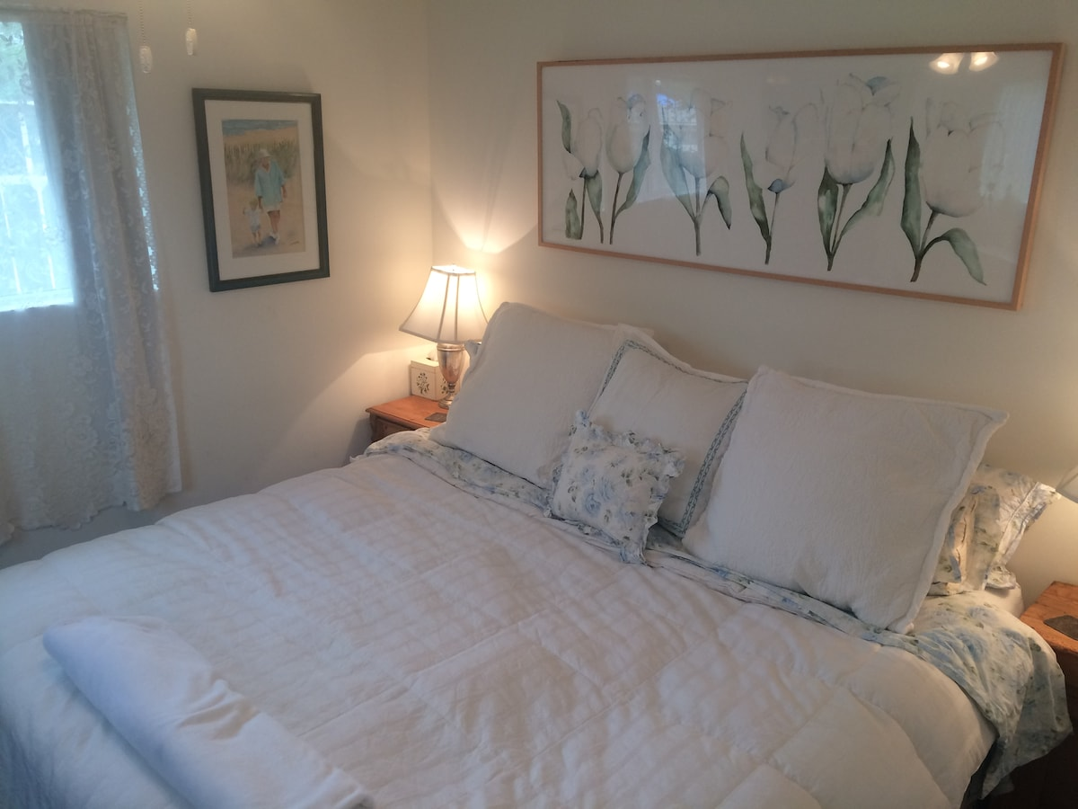 Master Bedroom has Organic King bed, New TV & Ceiling Fan
