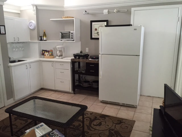 Kitchen area, has all the basic needs including a full sized refrigerator, single burner induction cooktop, electric skillet, coffee maker, microwave and convection / toaster oven.