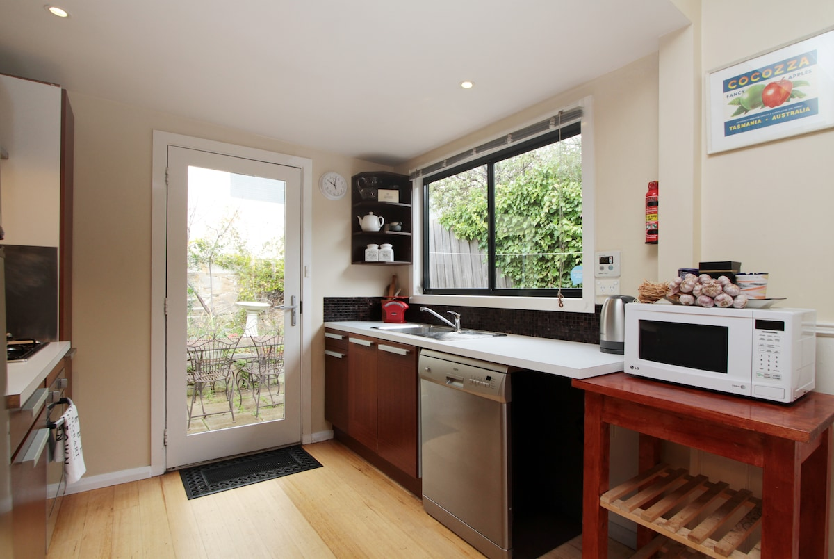 Modern galley kitchen - gas and electric cooking - sandstone courtyard.