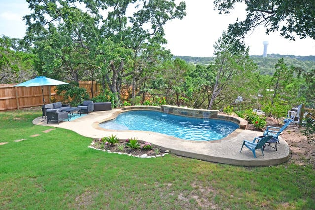 A private pool with a view of the surrounding hills.