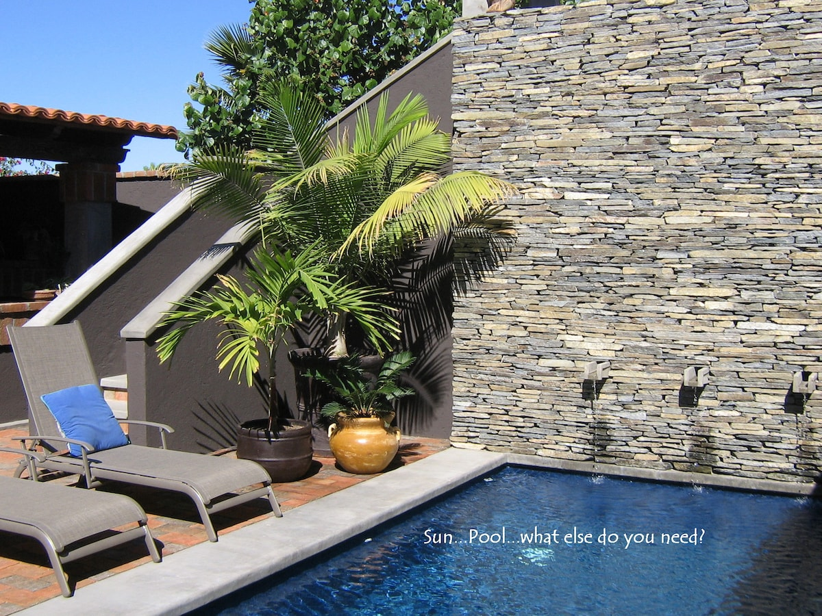 Our Pool and Stacked Rock Wall...the Guest Sun Patio area and stairway to the Upstairs Studio