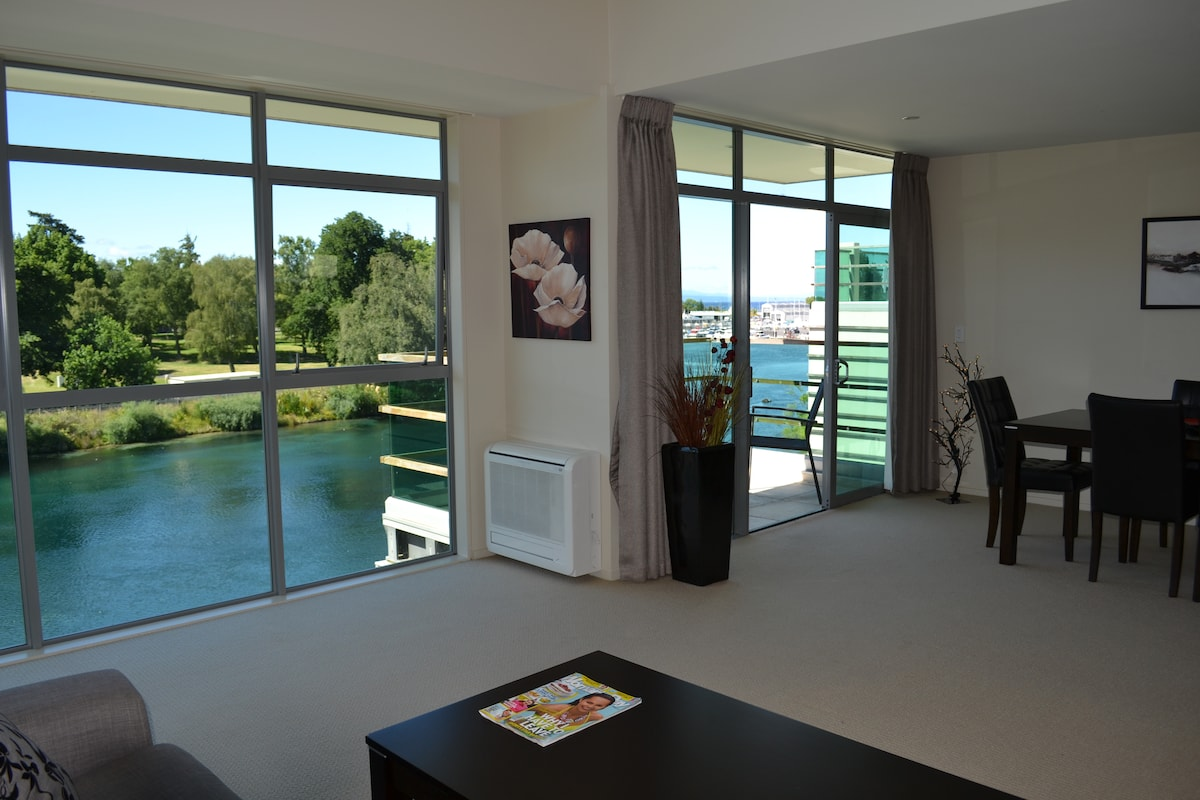 Wonderful views from the lounge, dining and kitchen over the river and park