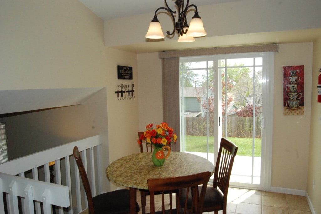Dining area next to kitchen with sliding door to patio and back yard