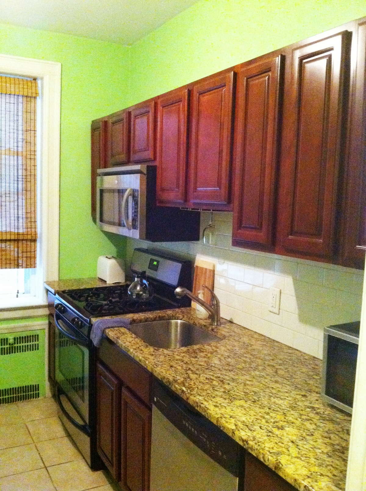 This kitchen is equipped with everyhting you will need. Granite countertops, stainless steel appliances and cherry wood cabinets.
