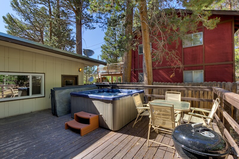Deck also features a charcoal bbq and patio furniture