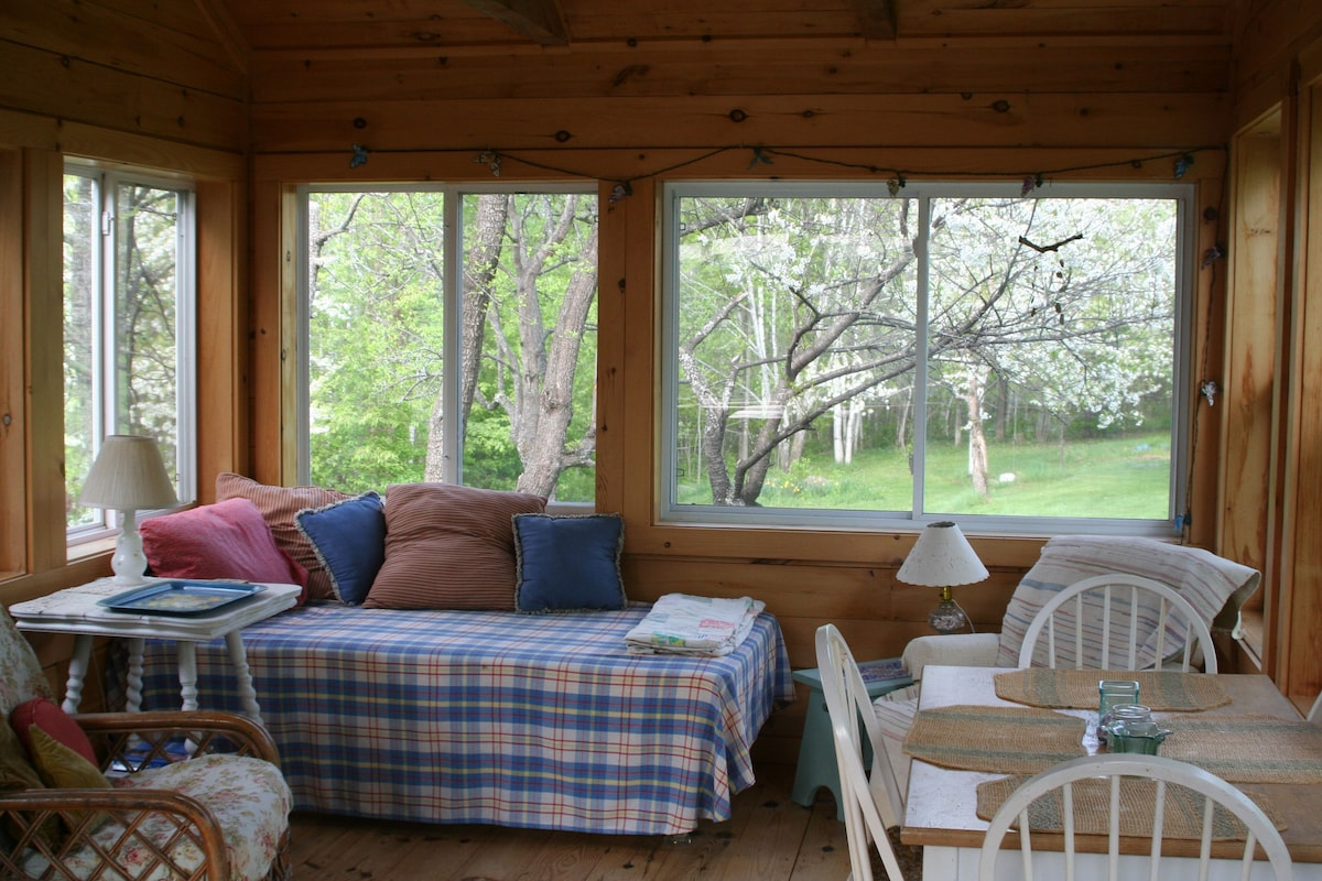 porch is lovely for reading, napping, dining & enjoying your morning coffee with the birds