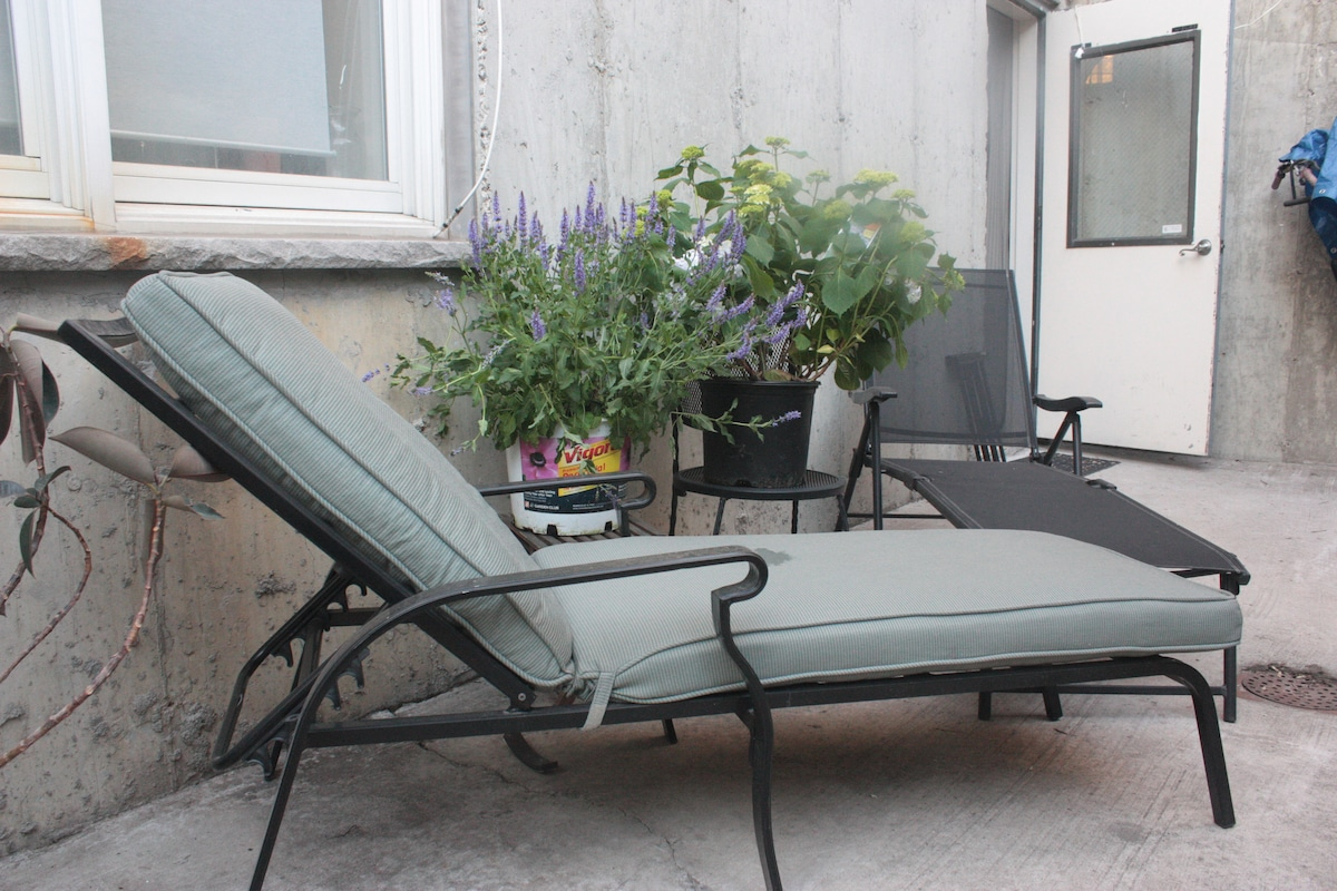 Patio with chaise lounge chairs.