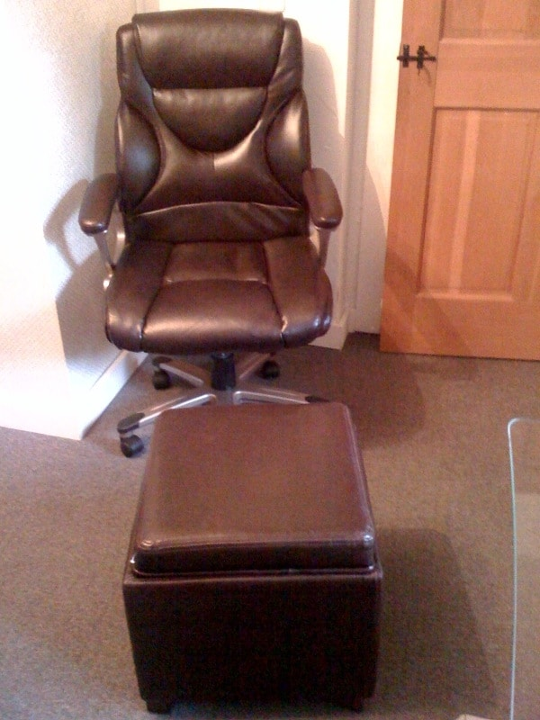 Comfortable chair with footstool