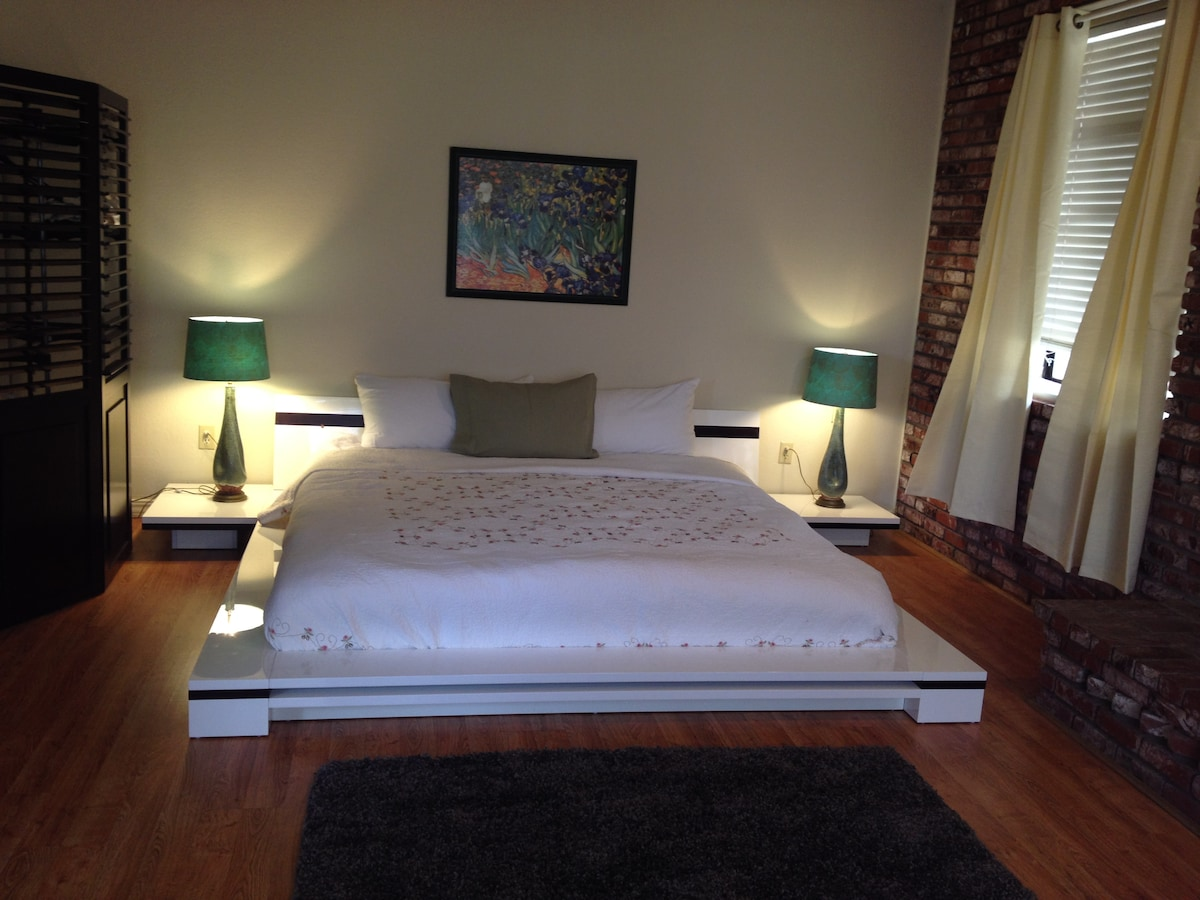 California king bed in large room