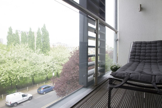Large, ensuite bedroom with balcony