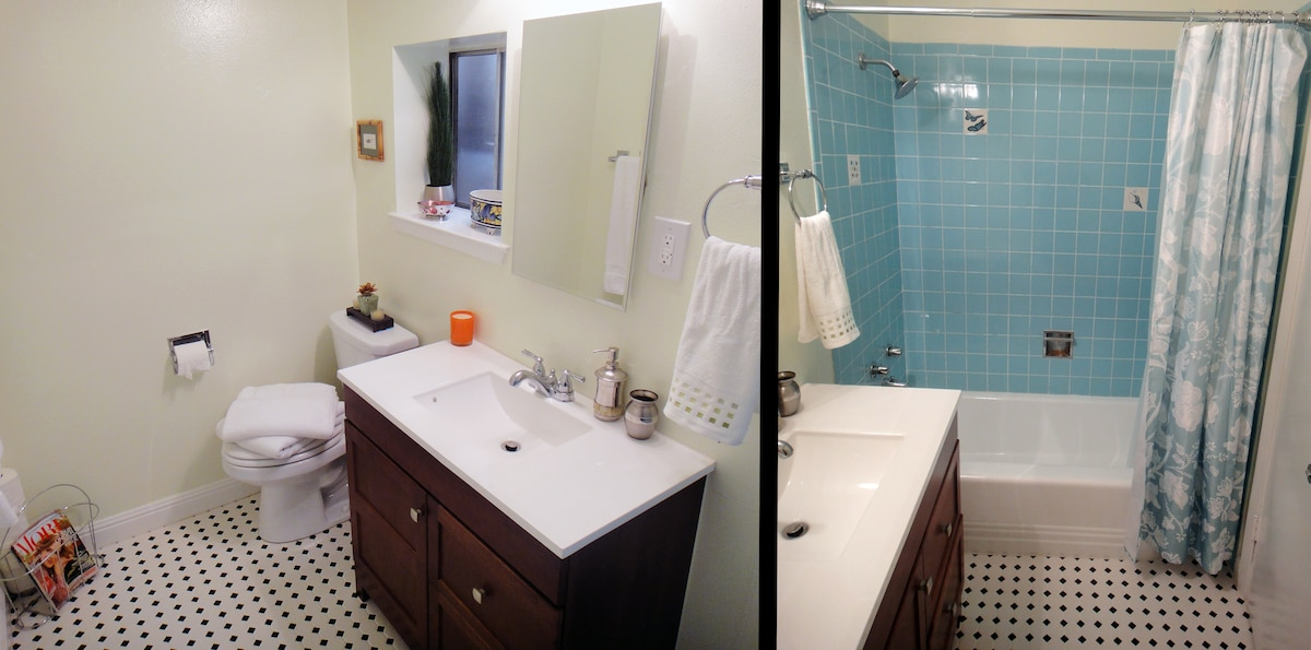 Bathroom has a shower and tub.