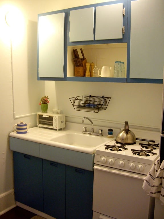 Full kitchen with gas stove and refrigerator, stocked with dinnerware, pot and pans and dishes for your use.