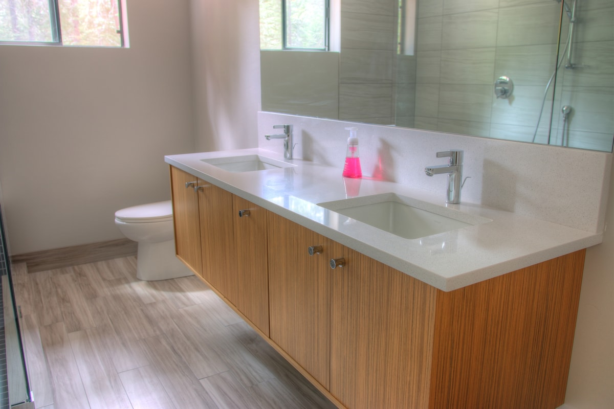 Downstairs bathroom with dual sinks and quartz counters