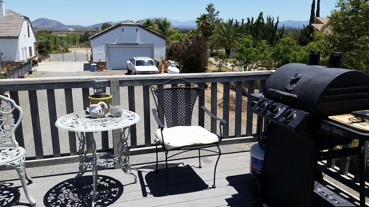 Views from upstairs patio, propane BBQ  for outdoor cooking.