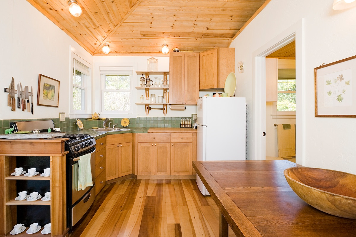 Handmade built-in cupboards, new gas stove, tiled counters, butcher block counter.