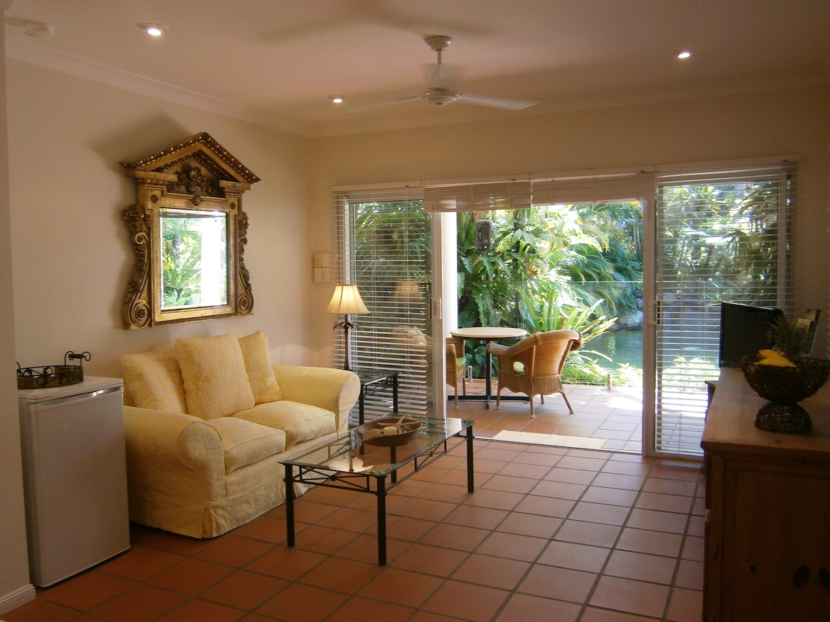 Lounge area overlooking verandah, pool and private tropical gardens.