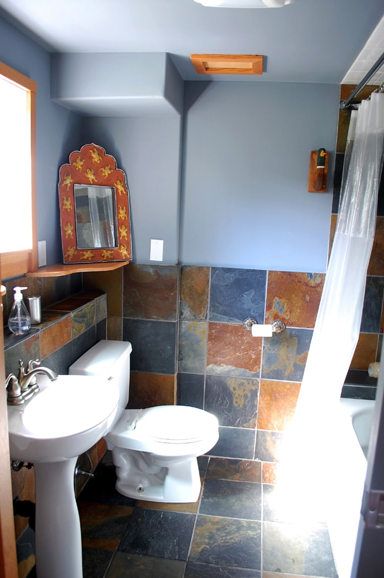 Heated slate floor and a jacuzzi tub.