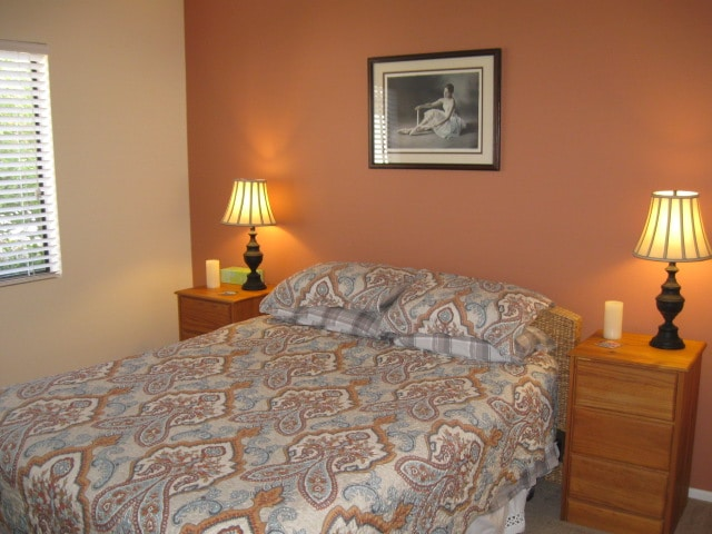 Corner room 1 with comfy queen bed, desk and chair, tall dresser, 2 small dressers, closet.