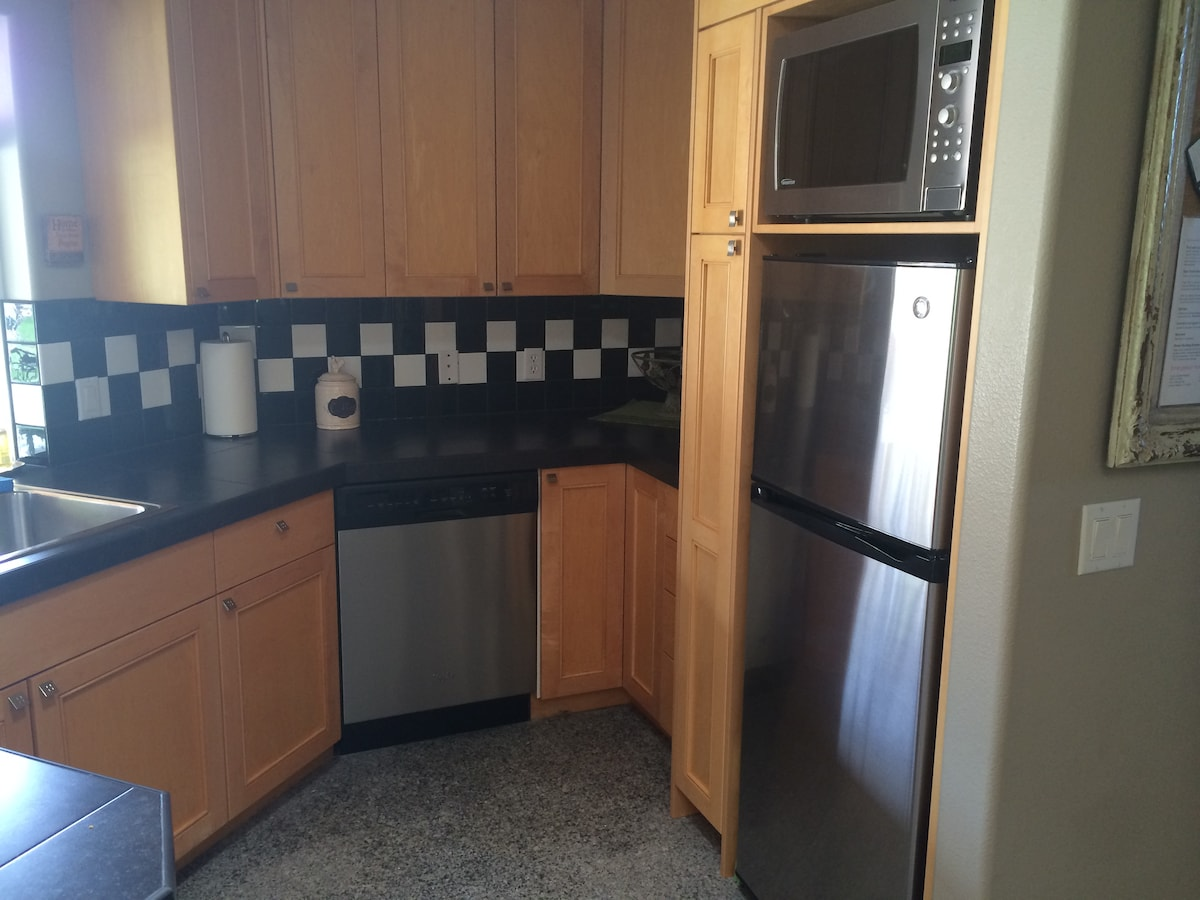 Kitchen.  Fully equipped with everything and then some. Dishwasher, large microwave with convection bake oven, 12 cu ft refrigerator with ice maker.