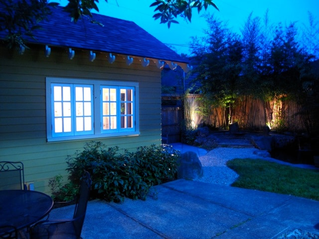 Exterior Night shot back patio & pond