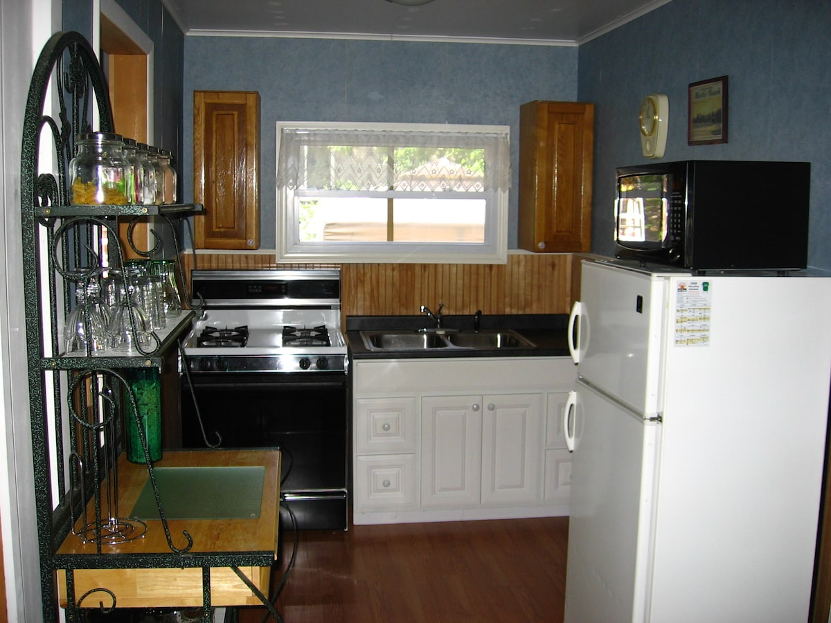 Kitchen, stove, microwave, refrigerator w/ freezer, coffee maker, silverware, glasses, plates, pots, pan..