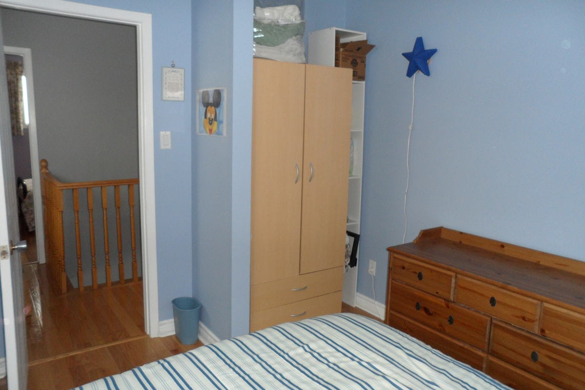 Blue bedroom has a wardrobe for your hanging clothes.
