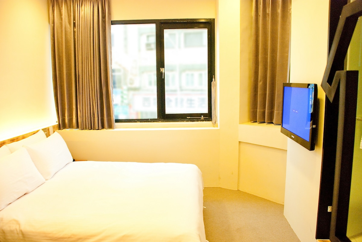 Medium Double room equipped with Air conditioning, LCD cable TV, phone, desk, 24 hours security, free bottled water and chips everyday