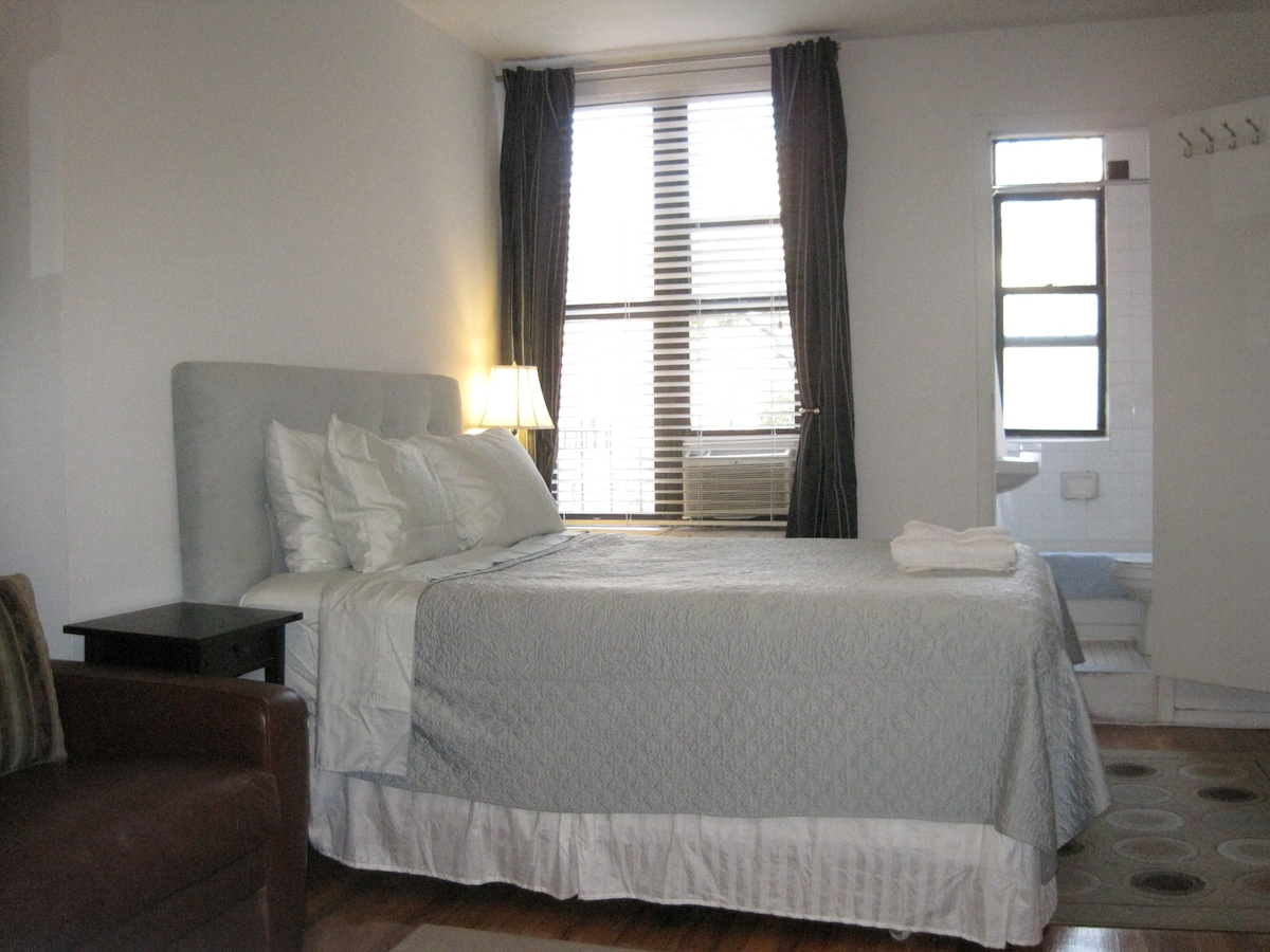 The apartment features a Queen-sized bed with a luxury firm pillowtop mattress (by Stearns and Foster)