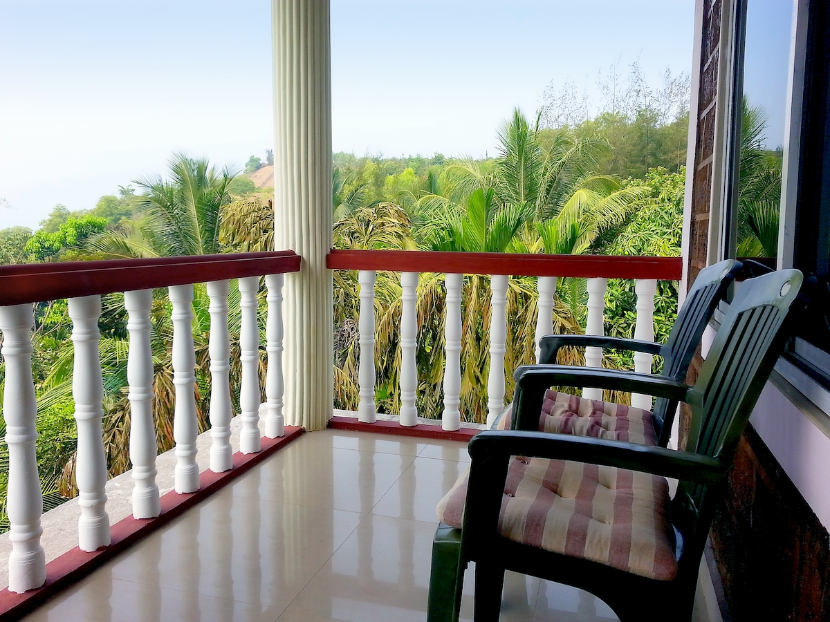 balcony view over the tree tops to kudle beach