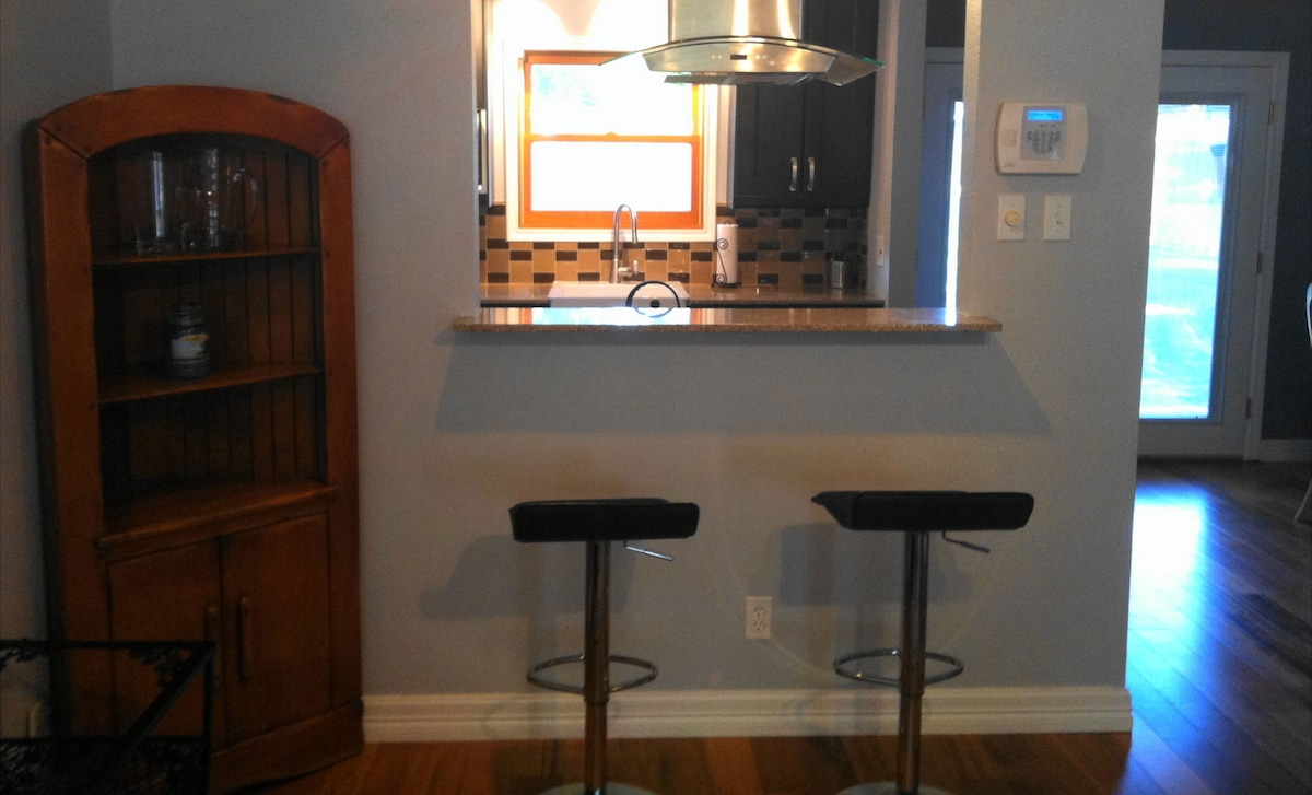 Looking at the kitchen with its stainless steel hood from the living room
