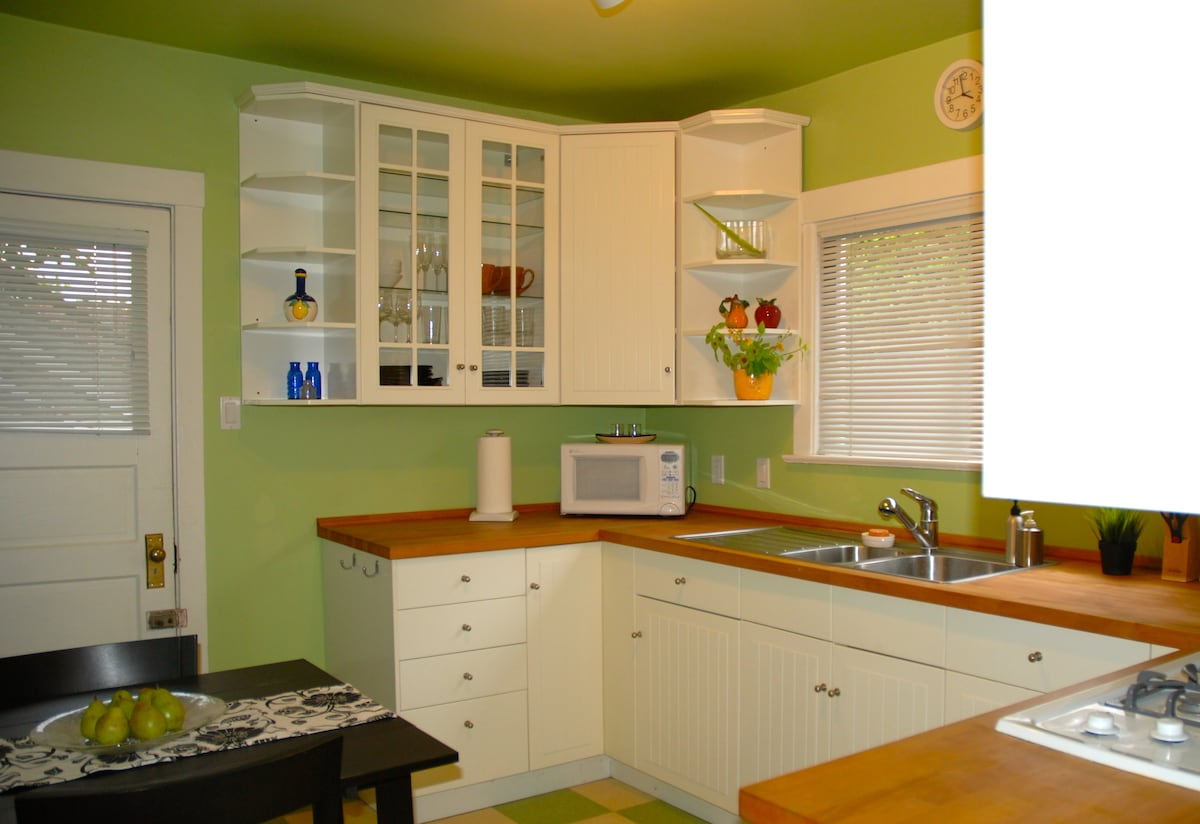 The famous green kitchen!  Bright, clean and spacious.  Walk to the fantastic Farmers Markets Tues and Sats and dine on the patio!