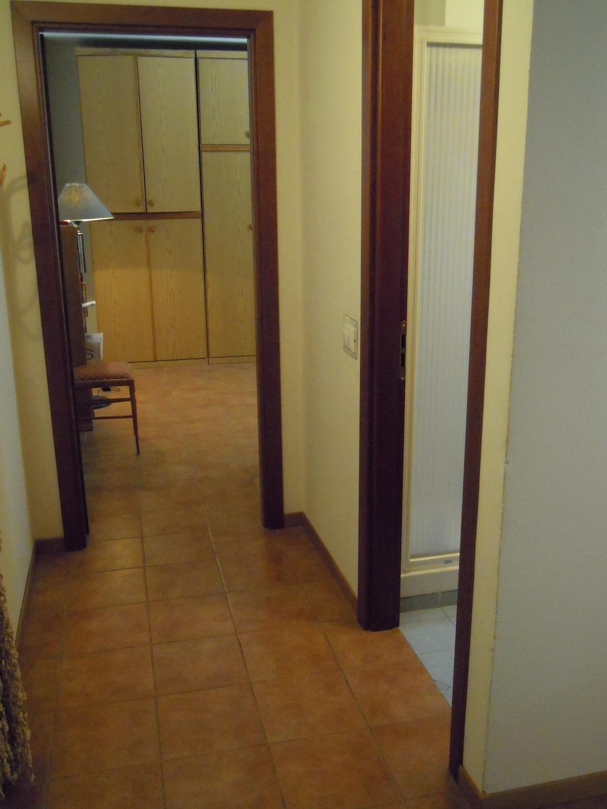 Small corridor - on the right: bathroom; straight: bedroom