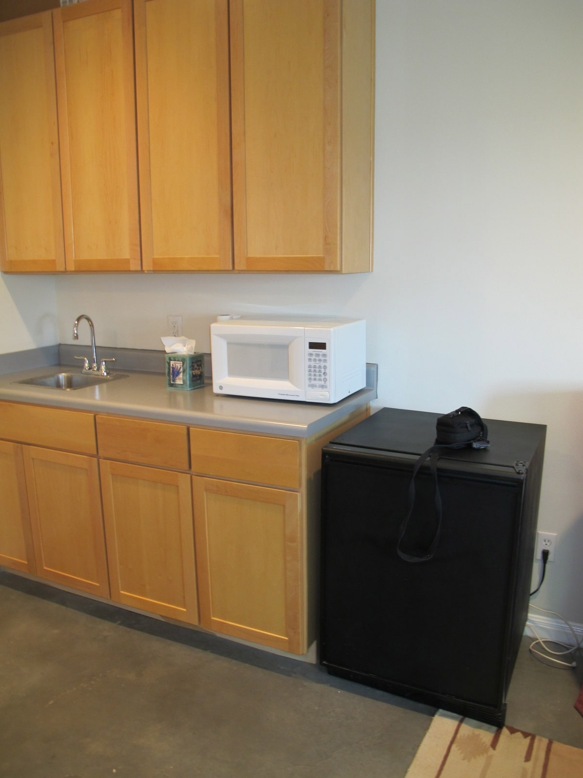 Kitchenette with microwave and small refrigerator