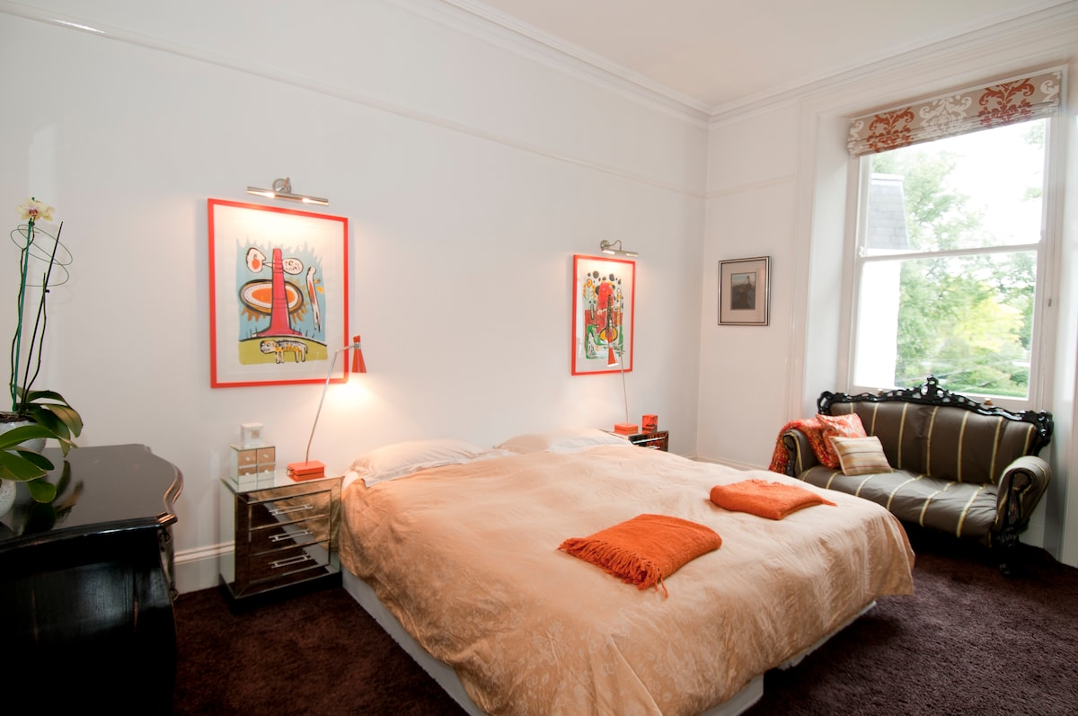 The large guest bedroom offers plenty of room to relax in privacy from the main flat.