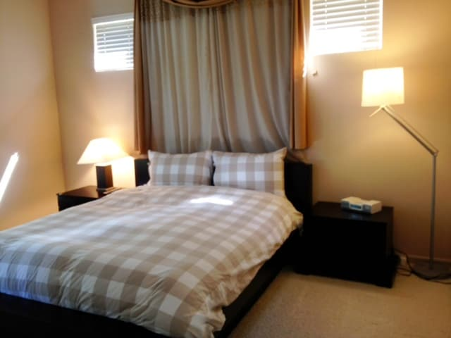 Master bedroom with fresh,  clean and comfy bedding