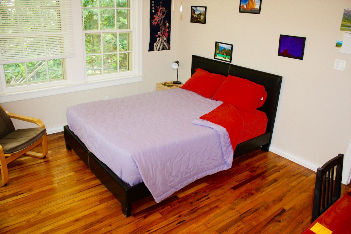 Second bedroom: another queen mattress, comfy chair & wall of nature photos