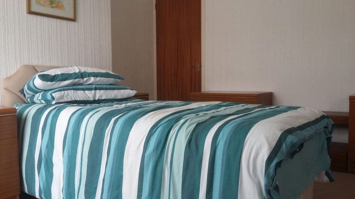 Single bed in spacious room